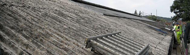 Coating an asbestos roof