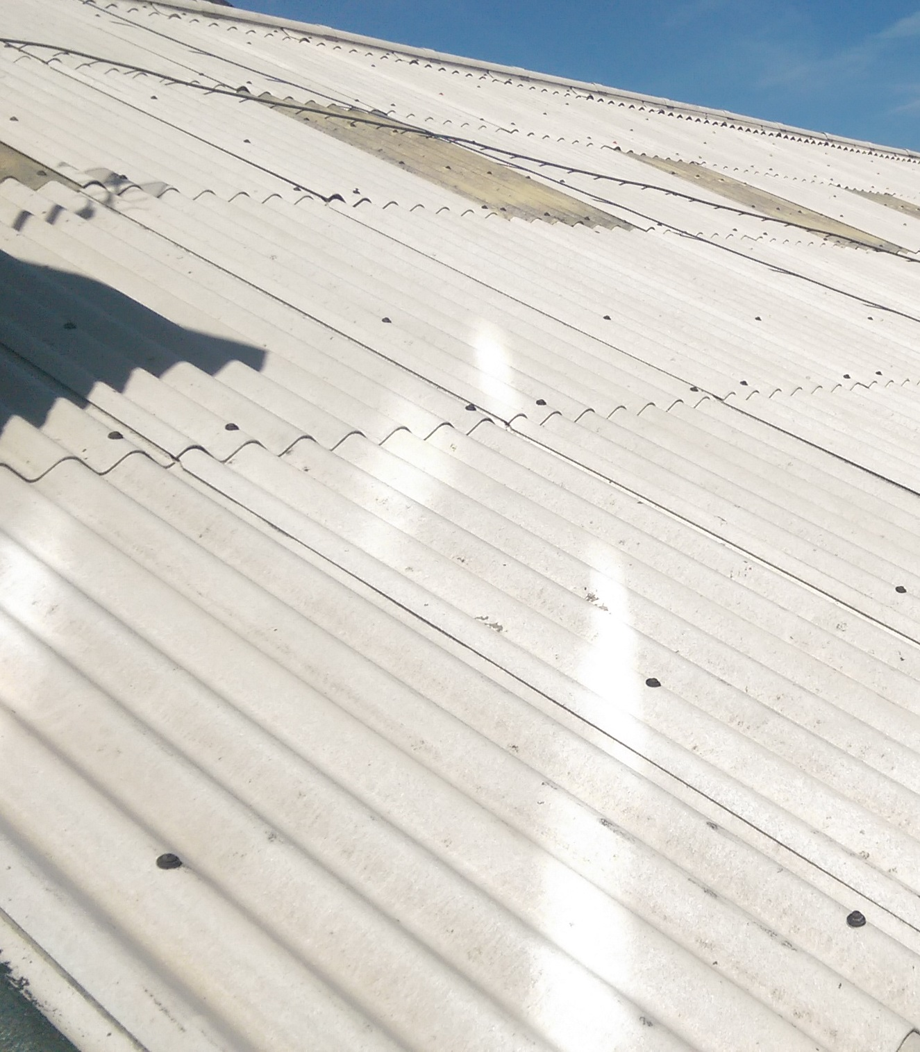 how to clean an asbestos roof