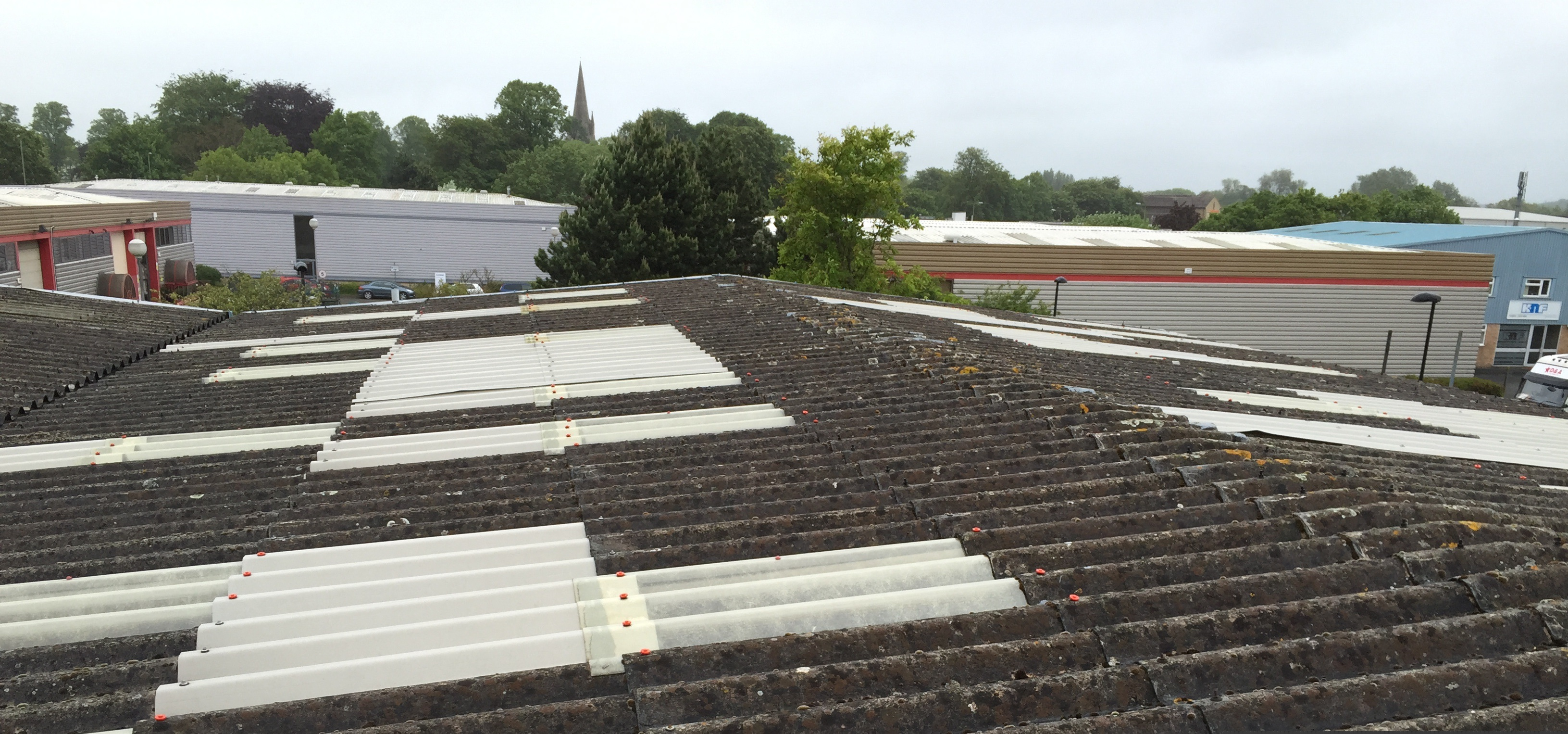 Before over Sheeting Asbestos Roofs