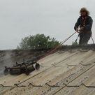 Asbestos roof coating about