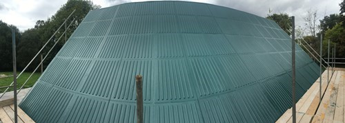 Green liquid rubber coating on roof